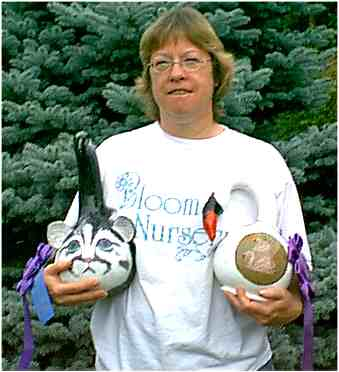 Martha Bloom with decorated gourds